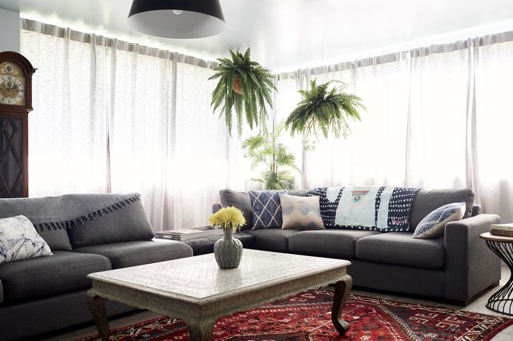 The beautiful patterned throw pillows and cushions in the living room are from Coco Mojo.