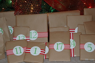 Present Advent - Children's Books and Treats wrapped to count down Santa's arrival.     I think this a great, and easy (if you start buying books in January and just continue throughout the year), idea for kids, to promote reading. :)