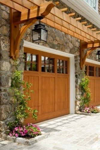 Love the pergola detail above the door.  Could be a very nice detail to add over our large shed garage door... #SummerLovin