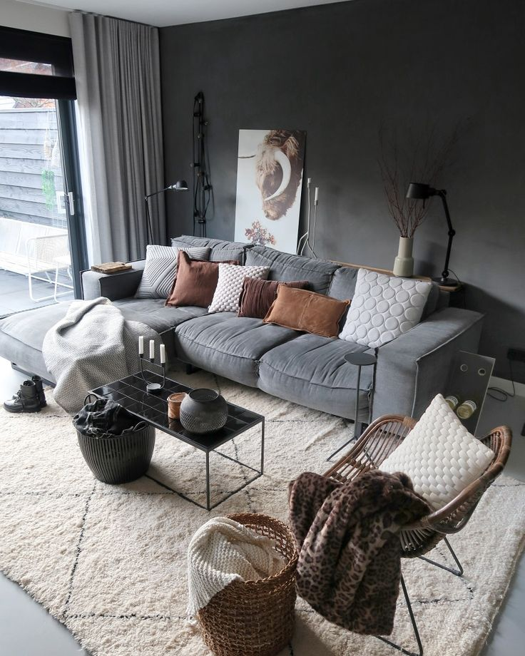 livingroom with a touch of autumn. grey couch with brown and grey pillows.