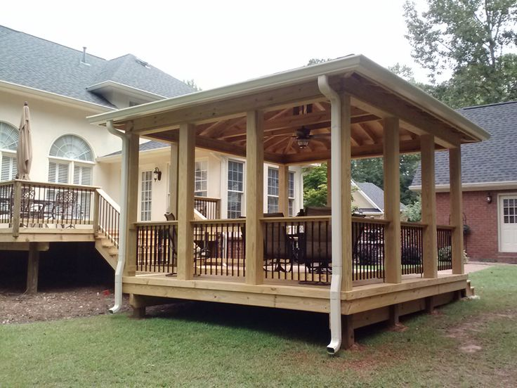 A gazebo and pavilion type structure attached to a deck provides protected outdoor living space. Notice the ceiling finish too.