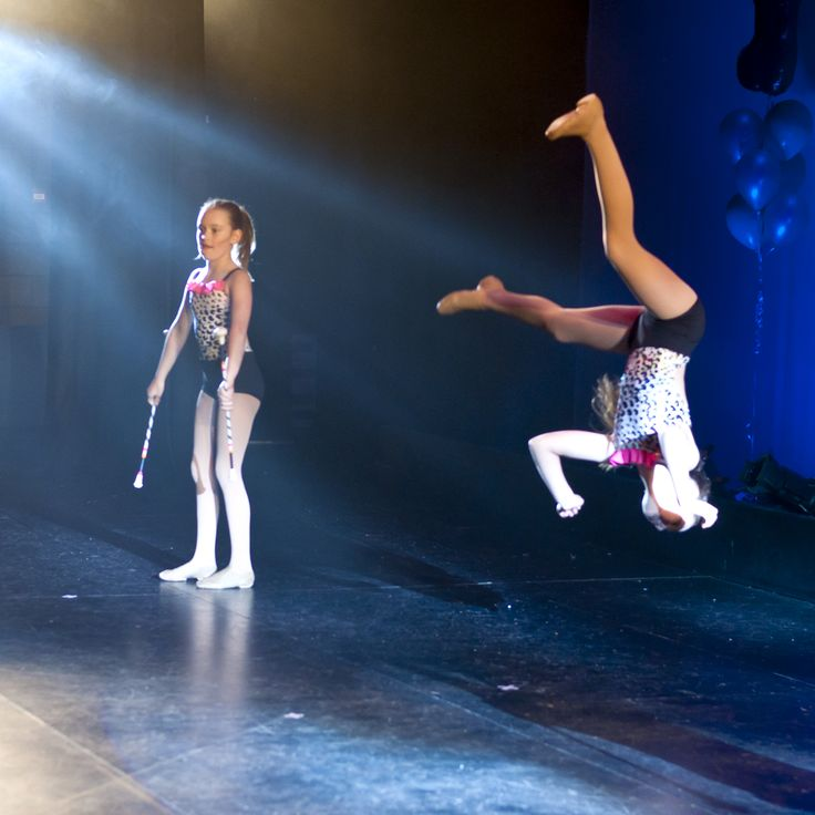 MID AIR! #batontwirling #dance #acro #concert #photography