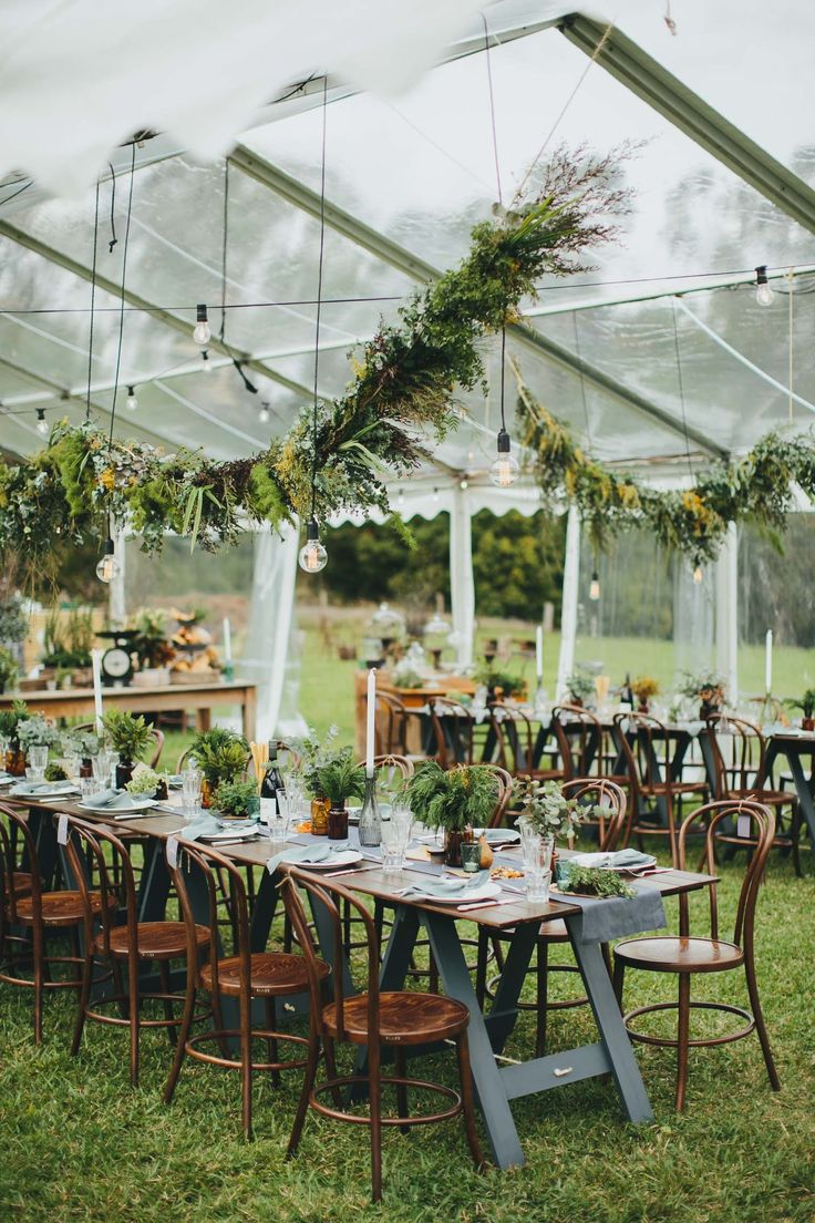 Hanging Greenery Hanging Lights And Rustic Wood And Metal
