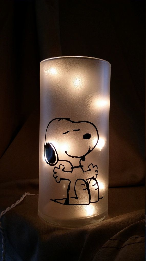 Snoopy! This light stands a little over 7  tall and is 3 1/4  wide Lights plug in from the back  Or choose a bottle 12 high