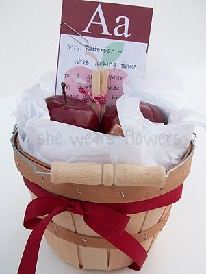 This is my favorite! It's a basket with apples, caramels and popsicle sticks with a recipe for caramel apples (although if I were the teacher I would just be lazy and eat them as-is)! The free printable includes the recipe and apple note card.