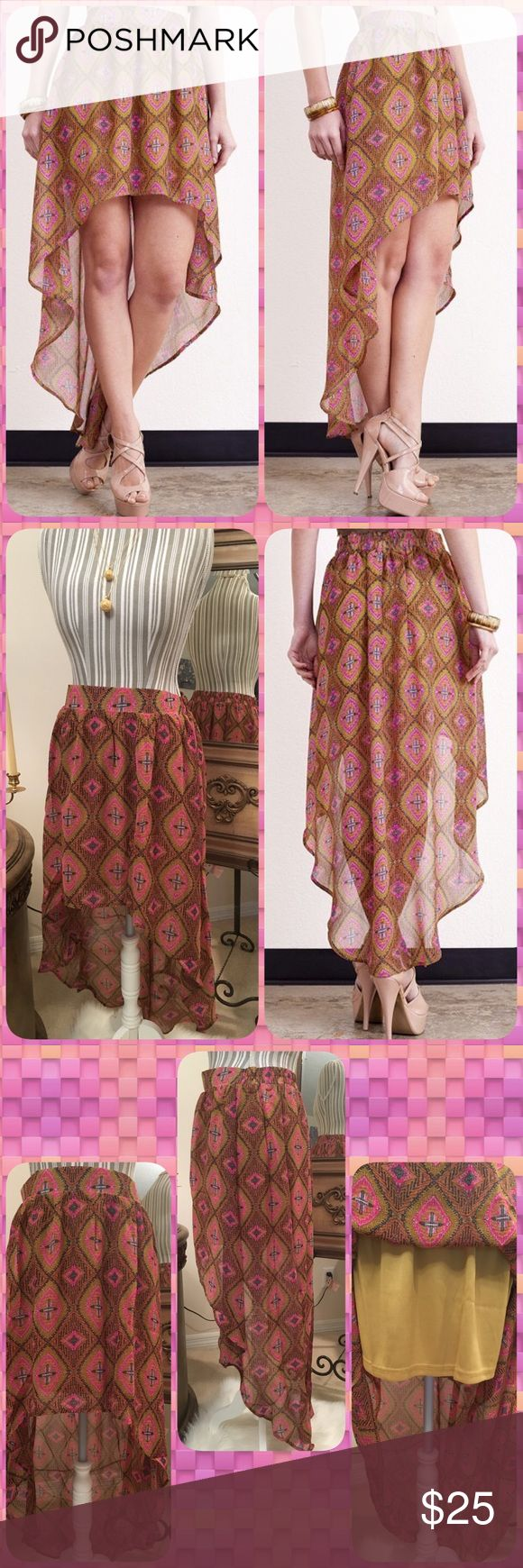 Hi-Lo Tribal Colored Skirt Gorgeous Tribal Colored Hi-Lo Skirt, beautiful and feminine! Lined with a gold colored skirt underneath and elastic waistband in the back only, very well made....55% Cotton 45% Poly...Sizes 2-4 (Small) 6-8 (Medium) 10-12 (Large) ✳️PRICE FIRM UNLESS BUNDLED✳️NO TRADES✳️ LDB Skirts High Low