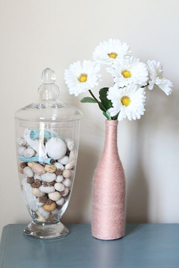 Recycle Bottles into Yarn Wrapped Vases - Here's an easy tutorial on how to recycle bottles into vases.