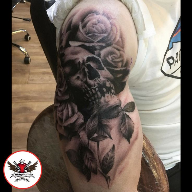 Skull and roses done using #magnumtattoosupplies by Mike Davies