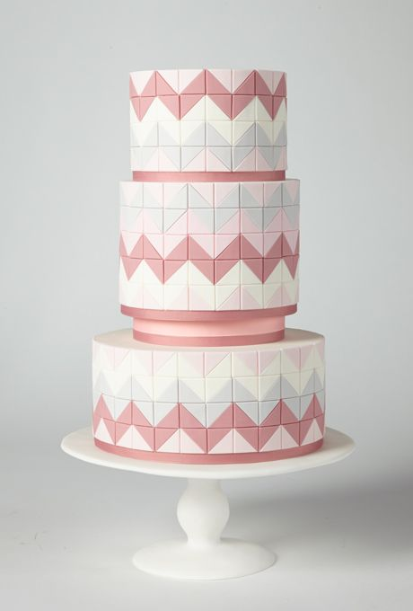 Brides.com: America's Prettiest Wedding Cakes. A Pink Chevron-Striped Wedding Cake. For an architectural twist on the chevron, baker Allison Kelleher used hundreds of hand-cut fondant tiles.  Cake by AK Cake Design, Portland, OR  Find a wedding cake vendor in Oregon.
