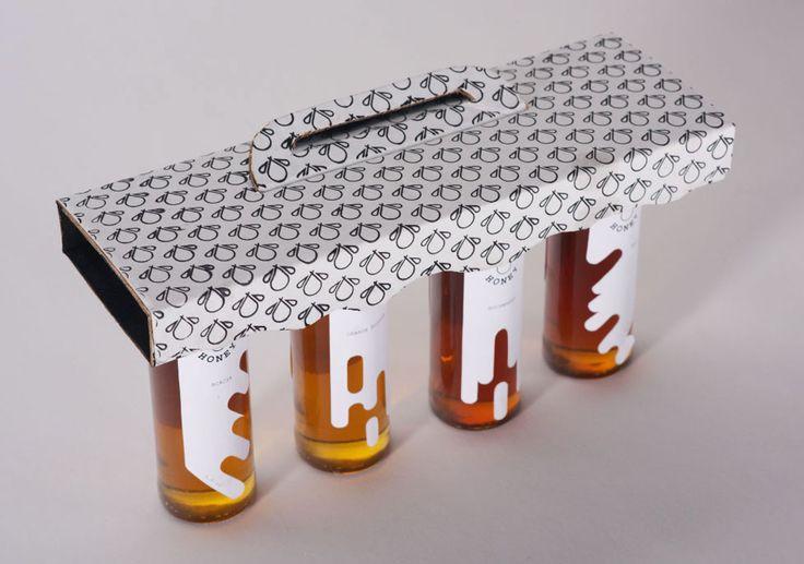 Дизайнер изБруклина Yinersi Gonzales разработала проект оформления длябренда wild honey иконструкцию упаковки его продукции— комплекта изчетырех сортов дикого меда.  Оформление этикеток илоготипа wild honey основано наобразе медленно текущего меда, логотип одновременно изображает капли меда истилизованный образ пчелы. Каждый тип меда имеет свою собственную уникальную форму этикетки. Белый цвет этикетки дополняет золотистый цвет меда вцилиндрической баночке. Все четыре банки меда…