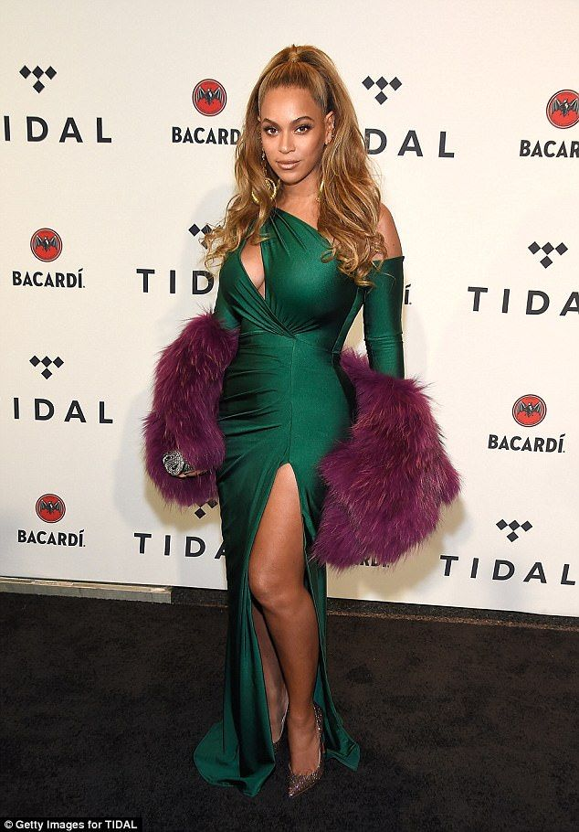 Emerald city: The 36-year-old looked sultry in a slinky emerald green gown. The dress feat...