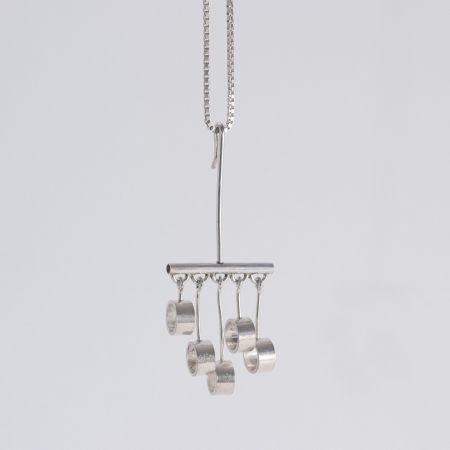 Kinetic silver pendant by Arne Johansen