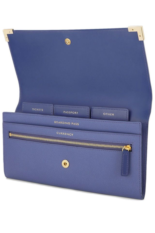 Regular sized passport holders never make sense—where are you supposed to tuck away that flimsy boarding pass? Instead, go for an oversized travel wallet like this one by Smythson. Smythson Grosvenor Corners Marshall Travel Wallet, $405; smythson.c