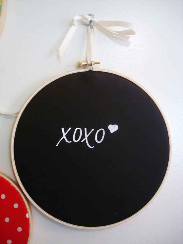 Chalkboard vinyl in embroidery hoops for versatile signs.