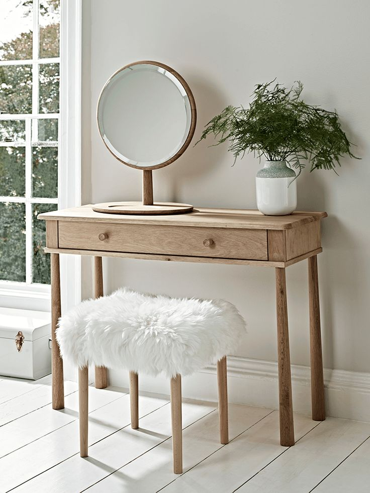 Slim and elegant in shape, our Scandinavian-inspired dressing table has slender, tapered legs and a smooth slide drawer for storage. Crafted from blonde mellow oak and flawlessly finished, it has a subtle wood grain and rounded edges. Pair with our Sheepskin Dressing Table Stool and Bergen Dressing Table Mirror to complete the look.