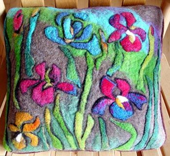Lovely needle felted pillow I've been coveting for at least a year.  I would love to create something as lovely as this. I bet I could too . . .