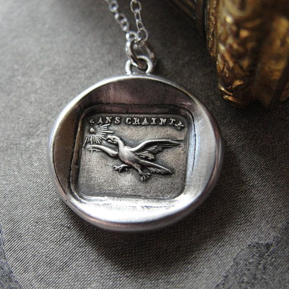 This listing is for one wax seal necklace with an eagle flying towards the sun.    The words framing this piece reads in French: Sans Crainte