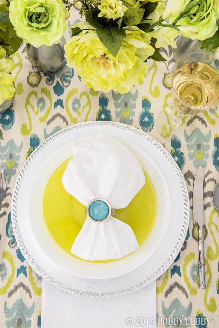 Layer neutral plate charger with bright plastic plates for an easy party setting!