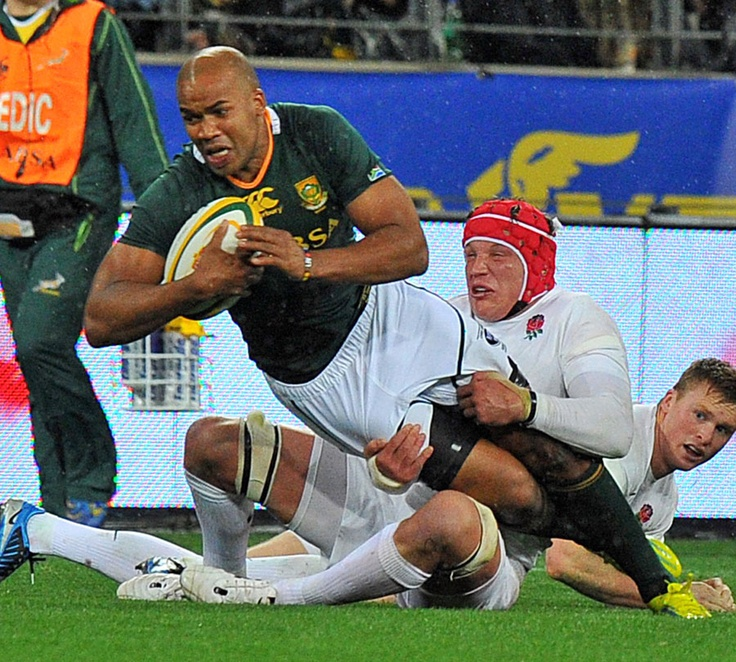 South Africa's JP Pietersen is tackled by England's Tom Johnson