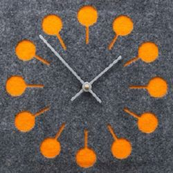 modern wall clock made of felt in orange and gray color. Could I make this using orange paint chips in the bg and a clock kit from joanns?
