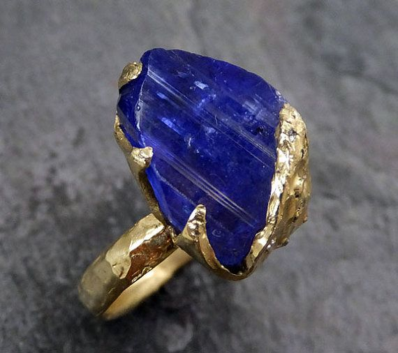 Raw Natural Tanzanite Crystal Gold Ring Rough Uncut Diamond dusted Gemstone tanzanite recycled 18k stacking cocktail statement byAngeline  I created this setting in wax then cast it in recycled solid 18k gold at my home studio. This lovely natural tanzanite crystal ring is a size 6 1/4 it can be sized.The tanzanite crystal measures about 15mm X mm I created a rustic texture in the gold and added several tiny raw diaonds to the prongs. Through out all of time and history in every tribe and…
