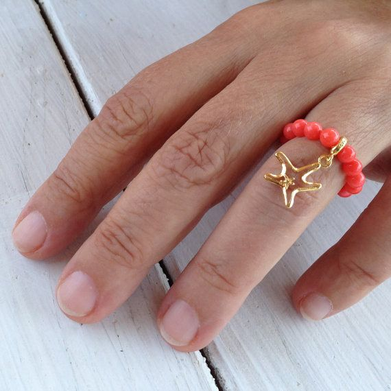 Re coral stacking ring Dainty stretch ring with natural coral beads and cute sterling silver 24 karat gold plated starfish charm Gemstone modern ring One size  Starfish charm : 0.5 inch / 12.7 mm wide stamped 925  The ring comes gift wrapped and ready for giving.  Here you may find more strech stacking rings: https://www.etsy.com/listing/237755788/gemstone-stretch-ring-with-24k-gold  This is more of my Rings collection: http://www.etsy.com/shop/PiscesAndFishes?section_id=12359176 and Here…