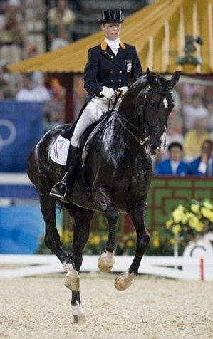 Anky van Grunsven of The Netherlands riding Salinero