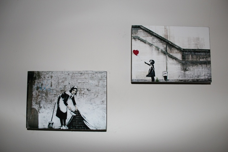Love my Banksy prints - I mounted them on wooden blocks