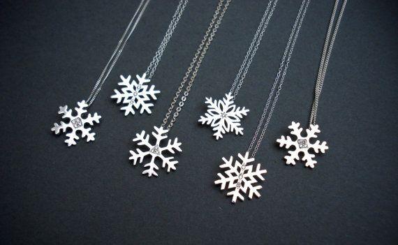 Diamond and Sterling Silver Snowflake pendants.