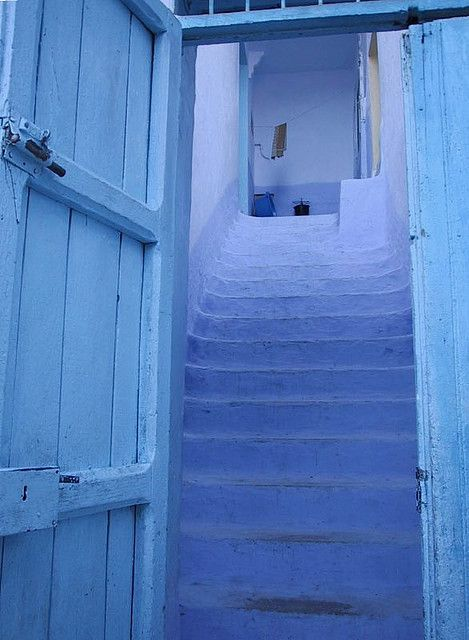 Blue:  Blue door opening on to blue steps.