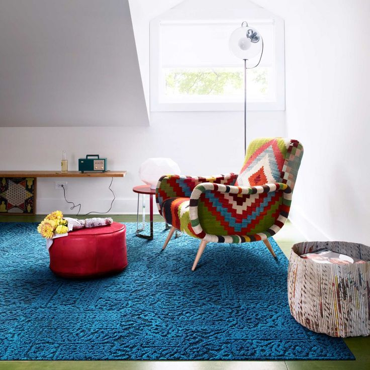This is a an ad for Flor carpet tiles but I'm obsessed with this funky chair!