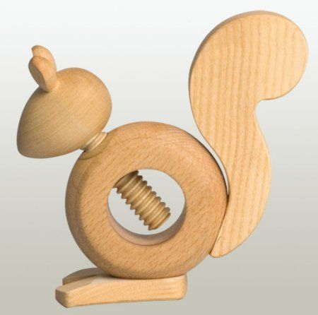 Nutcracker: Handcrafted by wood artists in the Erzgebirge region of Germany. Turn the squirrel's head, & the wood screw cracks open the nut.