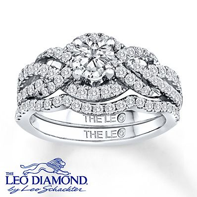 Lassos of extraordinary round diamonds flow around the magnificent round Leo Diamond center of the engagement ring in this breathtaking bridal set for her. Additional round diamonds line the matching wedding band, contoured to fit alongside the engagement ring. The central diamond is independently certified and laser-inscribed with a unique Gemscribe® serial number. The bridal set is crafted of lustrous 14K white gold and has a total diamond weight of 1 1/4 carats. Diamond Total Carat ...