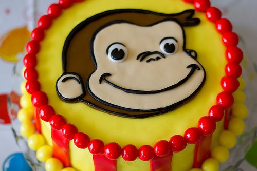 Curious George birthday cake - I like the idea of using candy as edging since I stink at frosting cakes