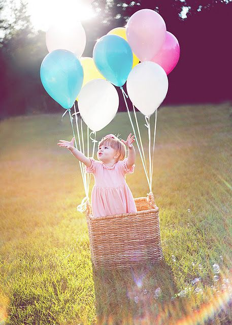 Balloons attached to basket,I SO want to take pictures of Avery with this prop. :D