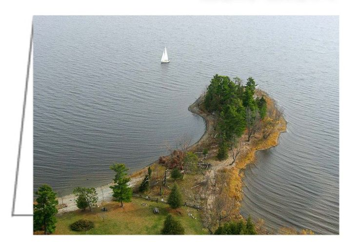 'Round the Point - Pinhey's Point, Ontario - Greeting Card. A kite aerial photography of a sailboat on the Ottawa River and just passing Pinhey's Point.