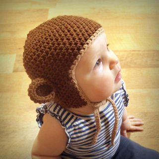 Monkey Hat (sizes newborn to adult) by Tara Murray This pattern is available for free.