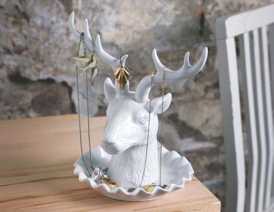 'Adorn' ceramic jewelry holder designed by Andrea Kezdi.  Who needs a taxidermist when you can have this picturesque ceramic deer trophy head instead? Dangle you favourite necklaces and earrings from the Adorn Jewelry Holder's anterls or keep those precious jewels in the catchall. You'll have fun dressing up this doe, a deer, a female deer $64.95.