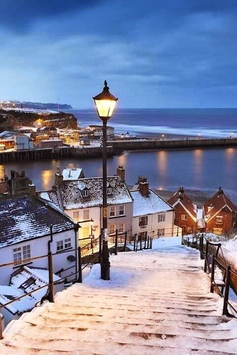 Whitby covered by snow, North Yorkshire, England - Mmmm, hot tea, warm blanket, fire place, sitting with your loved one near the window and watching how the snow is covering the streets of Whitby, i a romantic  moment of a lifetime. Honeymoon doesn't need to be on the beach, this is also a good option :)