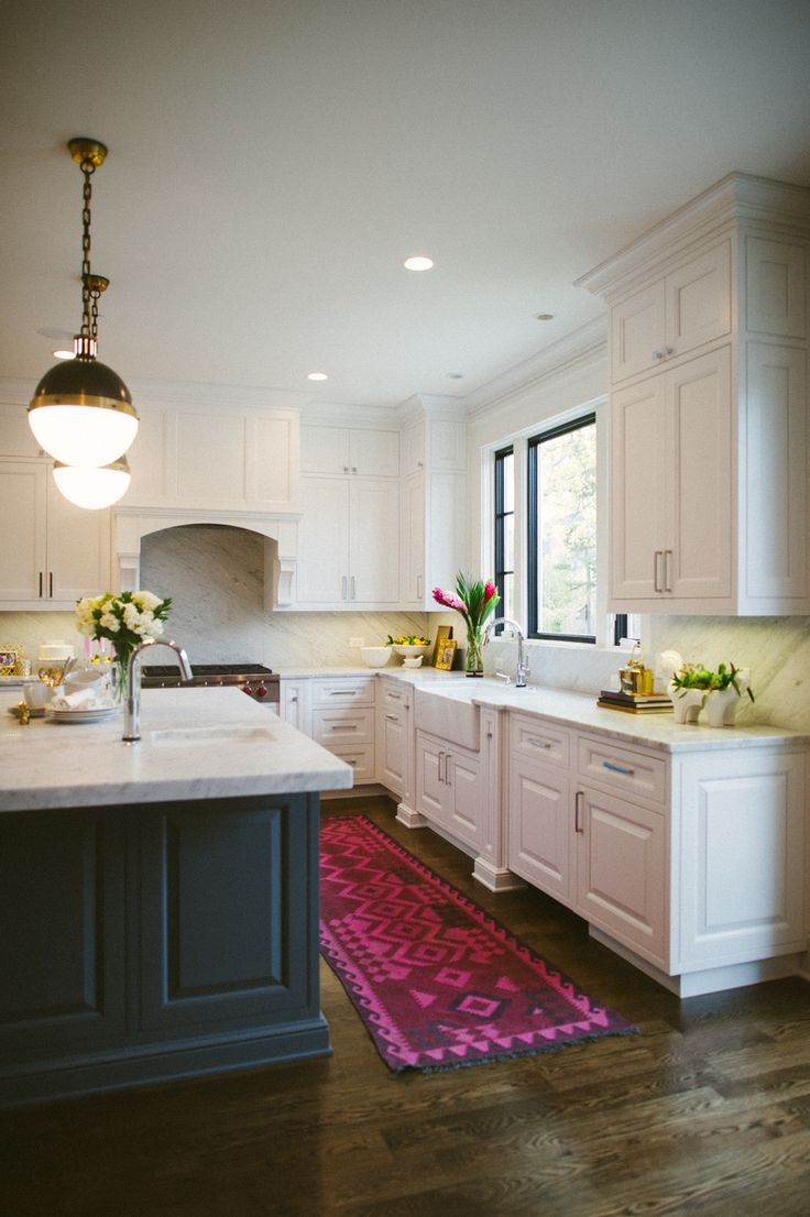 White kitchen cabinets with gray island cabinets, marble counters