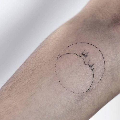 Fine line moon tattoo on the right inner forearm. Tattoo artist:...