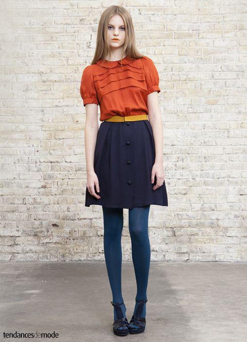 orange blouse, mustard belt, navy skirt, teal tights,