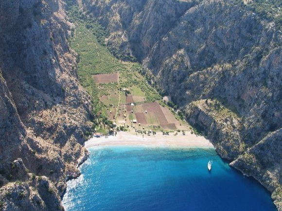 Butterfly valley/ Turley/ It is a wonderful valley and a natural treasure located 5 km (3.1mi) away from Oludeniz in the direction of Kabak bay after Kidrak beach. Butterfly valley is formed on the foot hills of mountain Babadag, surrounded with steep 350 m (1.150ft) high rocky hills.