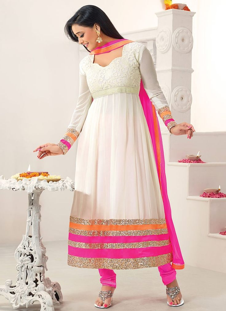 Lovely shweta tiwari off white chriidar suit featuring embroidered decorative pattern enhanced yoke part. Contrast bold alternate sequins enhanced patch over hemline gives it a look on those special l...