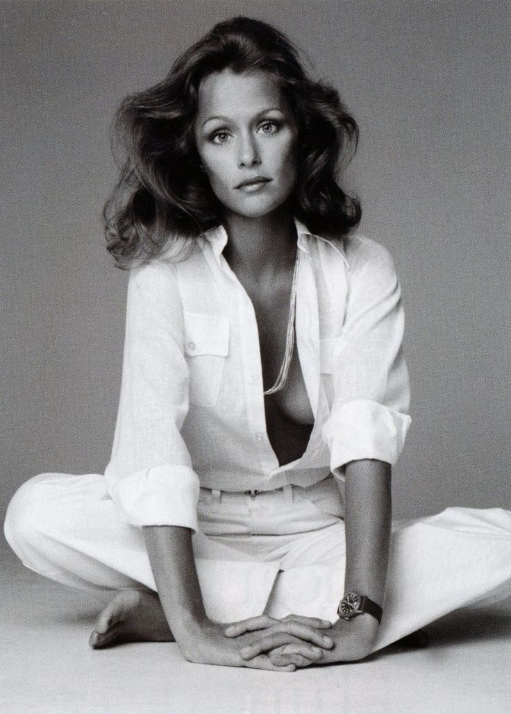 white shirt, white jeans and silver jewelry ~ Lauren Hutton ~ Vogue June 1973