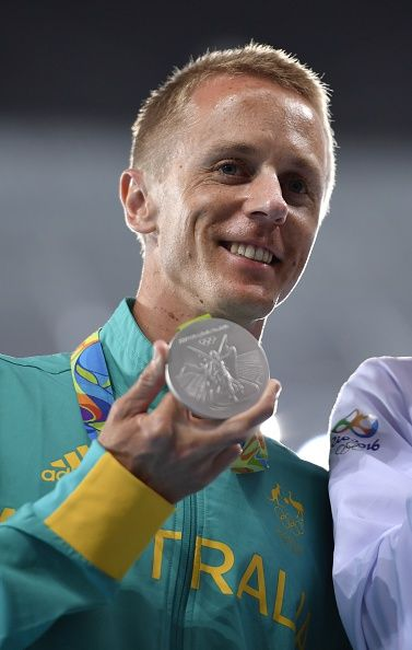 Australia's Jared Tallent poses during the podium ceremony for the Men's 50km Race Walk during the athletics event at the Rio 2016 Olympic stadium in...