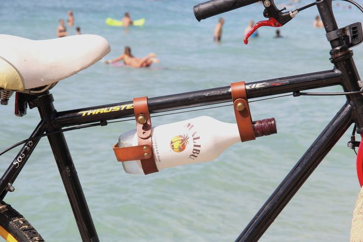 The handmade leather Bicycle Wine Rack is not just for wine - your Malibu bottle will fit too! Surf's up and shop now cyclestyle.com.au RG @oopsmark #cyclestyle #bikeshop