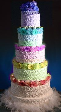Rainbow wedding cake (found on uglyweddingcake.com!).  Well, I guess to each his own, because I don't think this cake is ugly...they could have skipped the feathers at the bottom though.