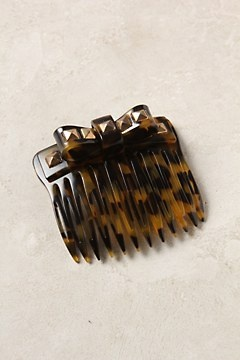 Lovely tortoise shell comb with some edge to it