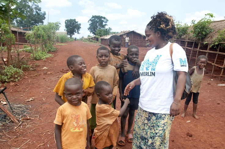 Merlin community health worker with children at Batalimo camp health facility, Central African Republic (August 2012)